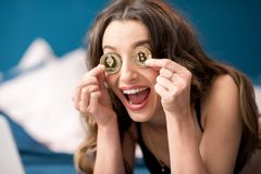 Woman with cryptocoins indoors