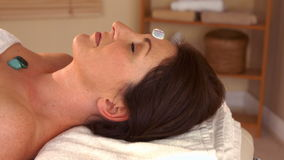 Woman at crystal healing session stock footage