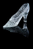 Woman crystal shoe. On the black background royalty free stock photography