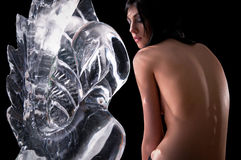Woman and a crystal statue Stock Photo