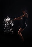 Woman and a crystal statue. Beautiful young woman and a crystal statue Royalty Free Stock Photos