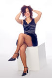 Woman on a cube royalty free stock photography