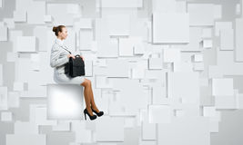 Woman on cube Royalty Free Stock Image