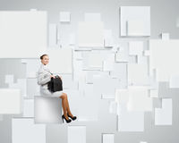 Woman on cube Stock Images