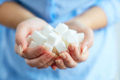 Woman with cubes of white sugar Royalty Free Stock Photo