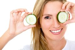 Woman with a cucumber Royalty Free Stock Photography