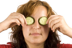 Woman and cucumber Stock Photography