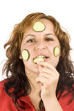 Woman and cucumber Stock Image