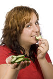 Woman and cucumber Royalty Free Stock Image