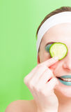 Woman with cucumber slice on eyes Stock Images