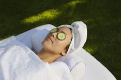 Woman With Cucumber Slices On Eyes Stock Image