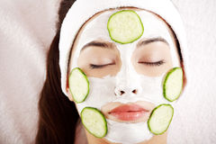 Woman with cucumber slices on the face Royalty Free Stock Image
