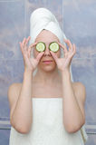 Woman with a cucumbers on eyes Royalty Free Stock Images