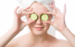 Woman with cucumbers on eyes Royalty Free Stock Image