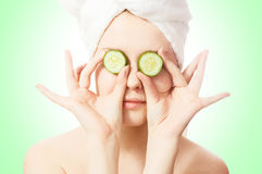 Woman with cucumbers on eyes Royalty Free Stock Photography