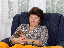Woman cuddles cat Royalty Free Stock Photography