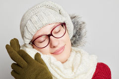 Woman cuddles with her scarf in winter. Woman wearing glasses cuddles with her scarf in winter Royalty Free Stock Photography