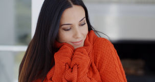 Woman cuddling down in her warm winter fashion Stock Images