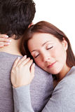 Woman cuddling with her boyfriend. While leaning onto his shoulder Stock Photography