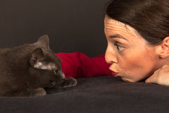 The woman is cuddling with her cat Stock Photos