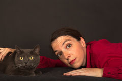 The woman is cuddling with her cat Royalty Free Stock Photo