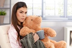 Woman cuddling with teddy bear Stock Images