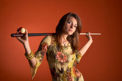Woman with cue Royalty Free Stock Photography
