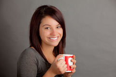 Woman with cup. An attractive young woman holding a warm cup of coffee, tea or coccoa Royalty Free Stock Photography