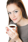 Woman with cup. Young beautiful woman holding a white cup of coffee isolated on white background Royalty Free Stock Photography