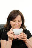 Woman with cup. A woman with closed eyes holding a cup in her hands Stock Images