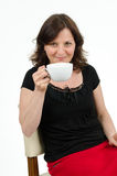 Woman with cup. A woman is holding a cup in her hand Royalty Free Stock Photo