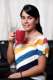 Woman and cup Stock Photos