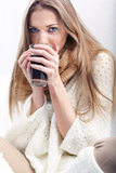 Portrait of a woman with a cup of coffee. Long-haired young blonde women with a cup of coffee Royalty Free Stock Image