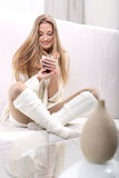 Morning with coffee - Woman with coffee cup. Long-haired blonde with a cup of coffee sitting on a sofa Stock Photography