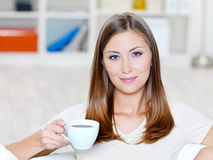 Woman with cup of coffee stock photo
