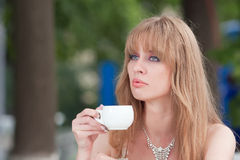The woman with a cup of coffee Royalty Free Stock Image