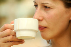 Woman with cup of coffee Royalty Free Stock Photos