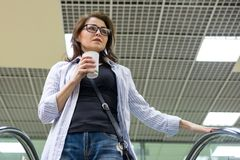 Woman with cup of coffee, background shopping mall stock photos