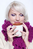 Woman with cup of coffee. Beautiful girl wearing winter clothes with cup of hot chocolate or coffee or tea Stock Photos