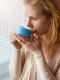 Woman with cup of coffee Royalty Free Stock Photography