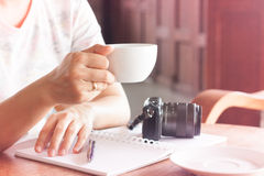 Woman with cup of coffee in coffee shop Stock Image