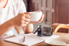 Woman with cup of coffee in coffee shop Royalty Free Stock Image