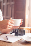 Woman with cup of coffee in coffee shop Stock Images