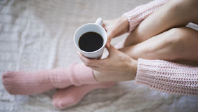 Woman with cup of coffee in hands. Top view point Stock Photo