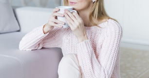 Woman with cup of coffee in hands. Top view point Royalty Free Stock Image