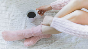 Woman with cup of coffee in hands. Top view point Stock Image