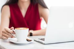 Woman with cup of coffee and laptop. royalty free stock photos