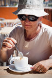 Woman with cup of coffee. Middle aged woman enjoying cup of coffee Stock Images