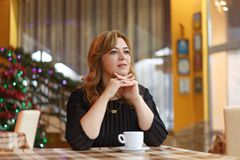 Woman with cup of coffee. In restaurant Royalty Free Stock Photography