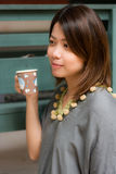 Woman and cup of coffee Stock Image